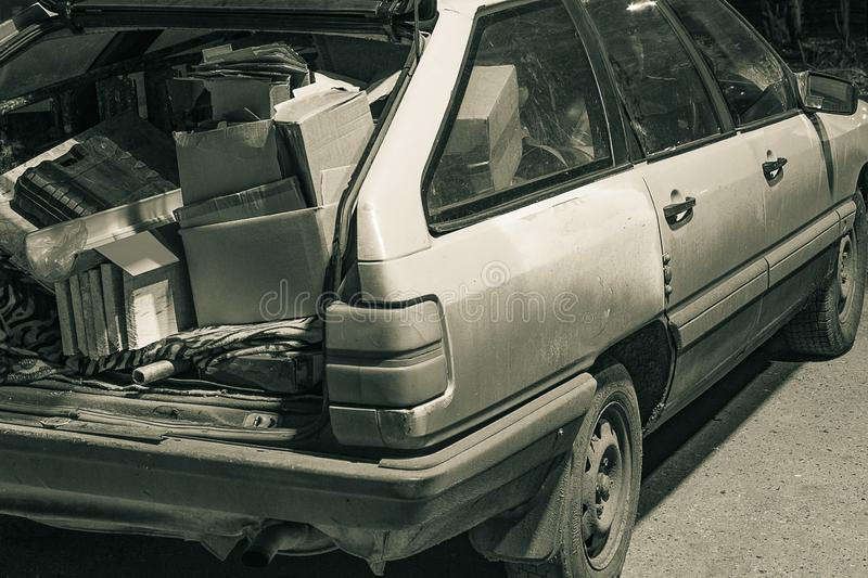 Unnecessary garbage carried in the trunk of an old car. Unnecessary garbage carried in the trunk of an old ca royalty free stock photography