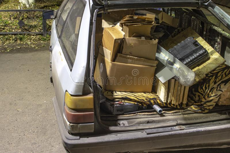 Unnecessary garbage carried in the trunk of an old car. Unnecessary garbage carried in the trunk of an old ca royalty free stock images