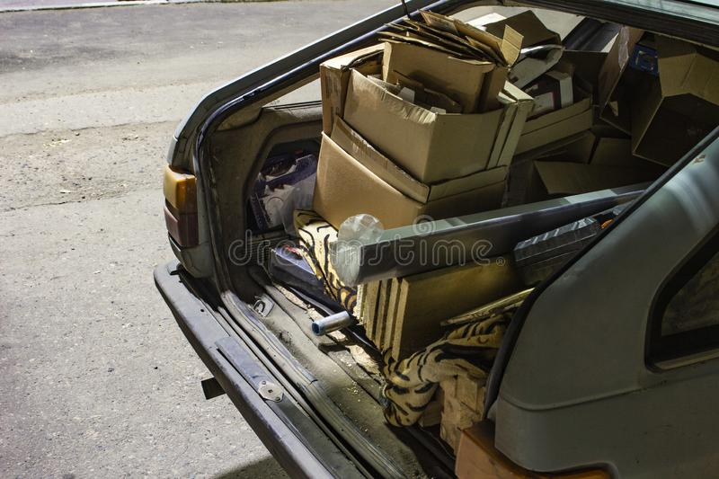Unnecessary garbage carried in the trunk of an old car. Unnecessary garbage carried in the trunk of an old ca stock photo