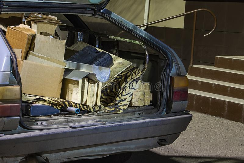 Unnecessary garbage carried in the trunk of an old car. Unnecessary garbage carried in the trunk of an old ca stock image