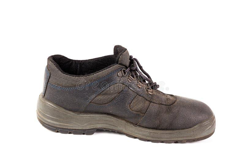 Uno ha utilizzato la scarpa di lavoro di cuoio blu con i incuts del tessuto isolati su fondo bianco immagini stock