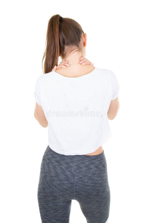 Uno mismo-acupressure trasero de la mujer joven de la visión para el hombro de relajación y el dolor de espalda imágenes de archivo libres de regalías