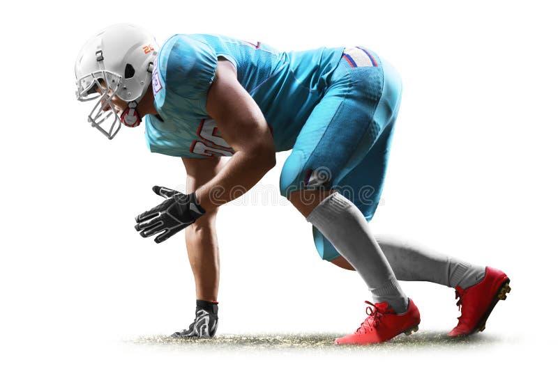 Uno studio dell'uomo del giocatore di football americano isolato su fondo bianco fotografia stock