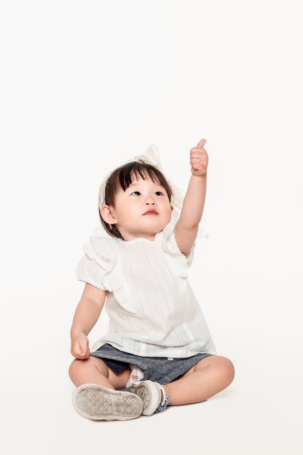 Uno studio ha sparato di un bambino piccolo coreano della ragazza immagini stock libere da diritti