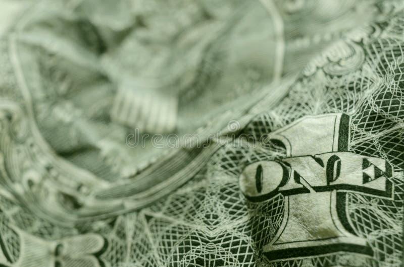UNO y 1 en billete de dólar americano eliminado foto de archivo libre de regalías