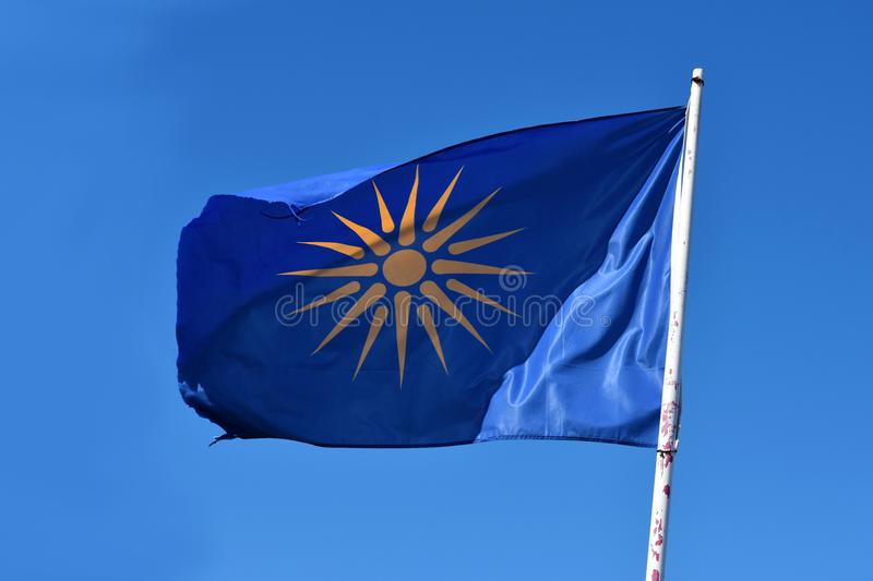 Unofficial flag of the Greek region Macedonia. The Vergina Sun on a blue background is commonly used as an unofficial flag of the three peripheries, the stock images