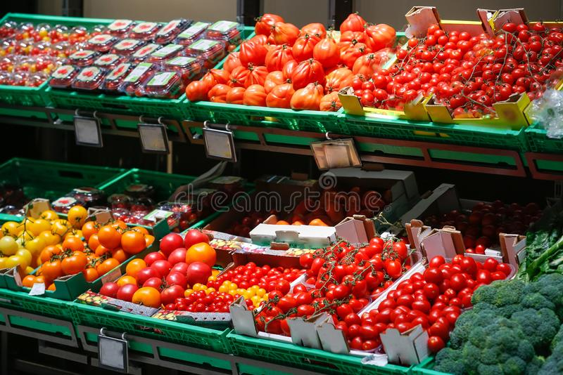 Unpacked, fresh assortment of tomatoes in a self-service supermarket stock image