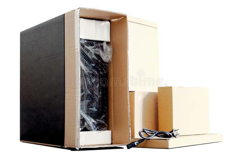 Unpacking black personal computer, back view, cellophane packaging. many boxes for desktop hardware parts. Isolated stock photo