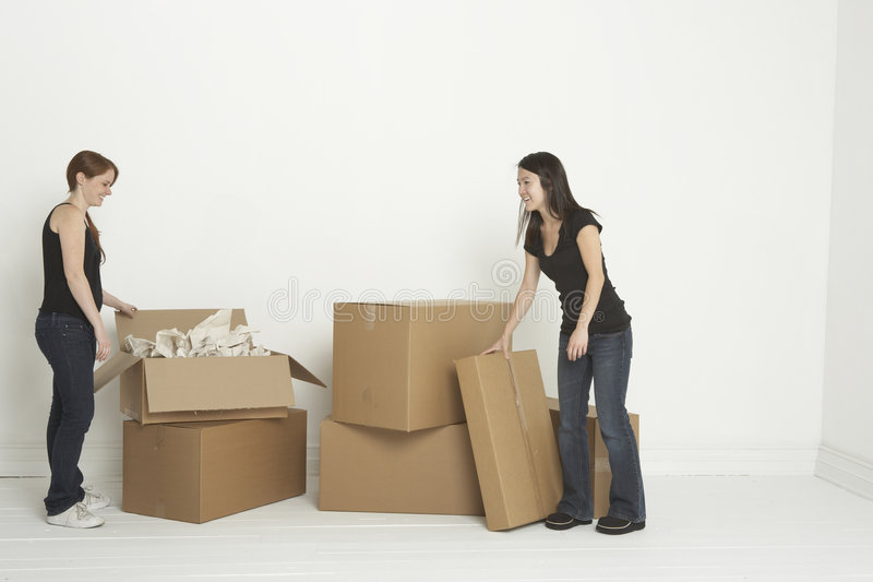 Download Unpacking boxes stock photo. Image of asian, smile, jeans - 5398040