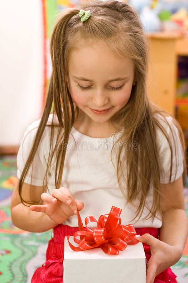 Download Unpacking the gift stock photo. Image of surprise, female - 3865312