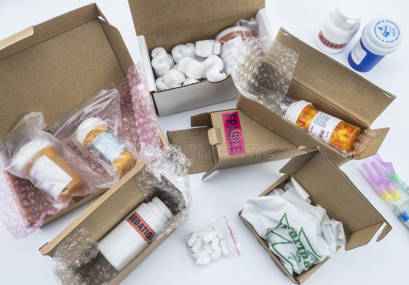 Unpacking medication in boxes, Diverse medicines in boxes for humanitarian aid. Conceptual image royalty free stock photo