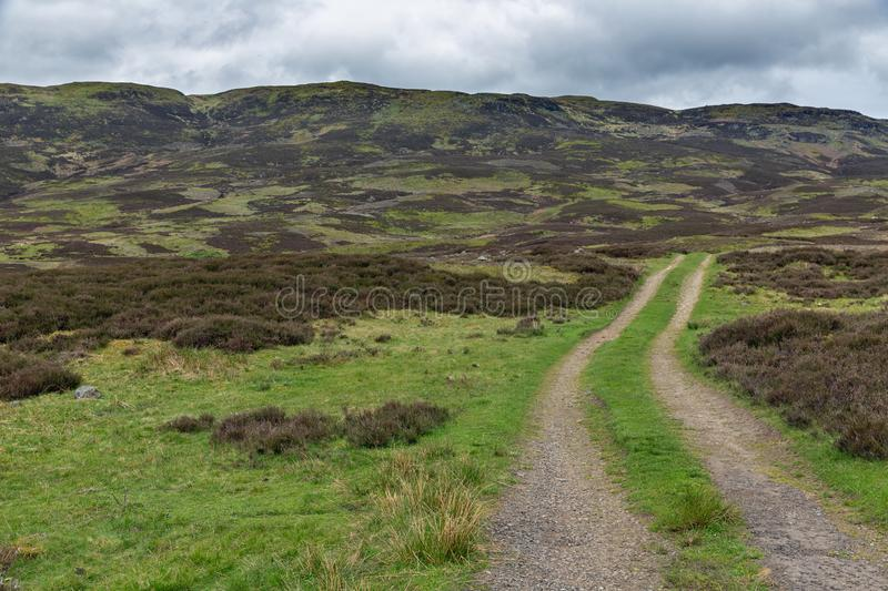 Unpaved country road in Scottish Highlands near Loch Tay. And Ben Lawers stock photo