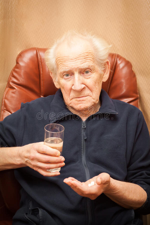 Unpleased old man with a questioning look royalty free stock images
