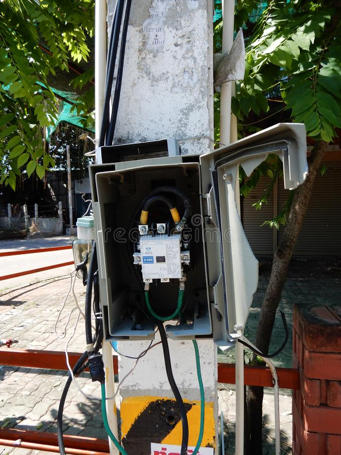 Unprofessional electrical installation. Uncovered electrical equipment here on a Pattaya street and ready for a shocking experience, Thailand stock photo