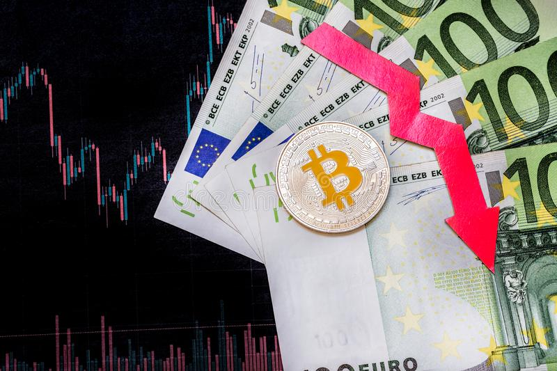 Unprofitable investment of depreciation of virtual money bitcoin. Red arrow, silver bitcoin and euro go down on paper forex chart royalty free stock images