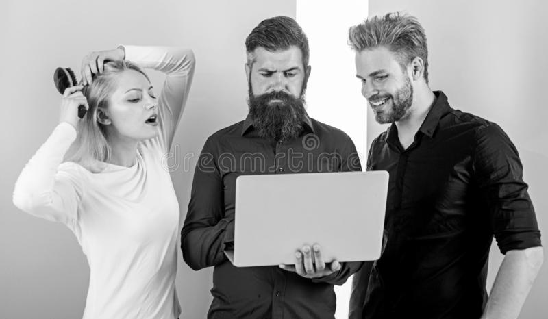 Unpunctual people usually annoying coworkers and breaking discipline system. How to be always on time. Work on your. Punctuality. Girl brushing hair while men royalty free stock image