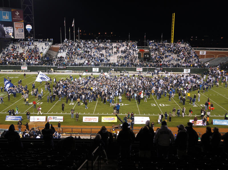 UNR Fan Cheer as players and fans celebrate field. SAN FRANCISCO - JANUARY 9: Fight Hunger Bowl - UNR vs. BC: UNR Fan Cheer as players and fans celebrate on the stock photo