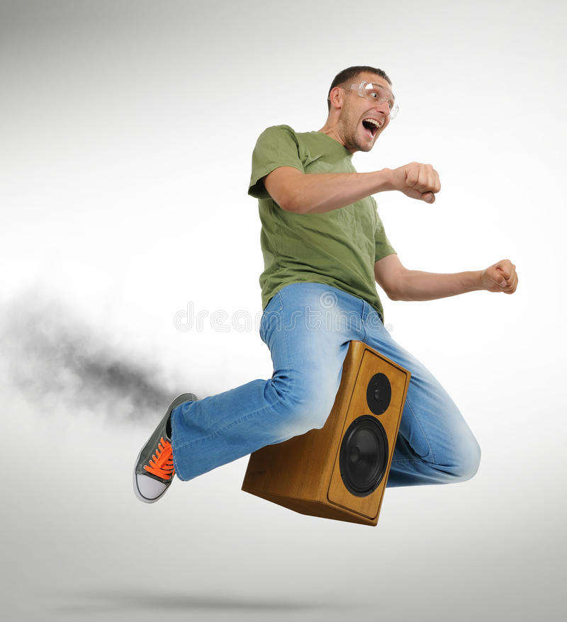 Download Unreal Flying Man Sitting On A Speaker Stock Images - Image: 21120974