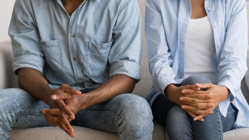 Unrecognizable Afro Couple Sitting On Couch At Marital Counselor`s Office. Unrecognizable African American Spouses Sitting On Couch At Marital Counselor`s Office royalty free stock photo