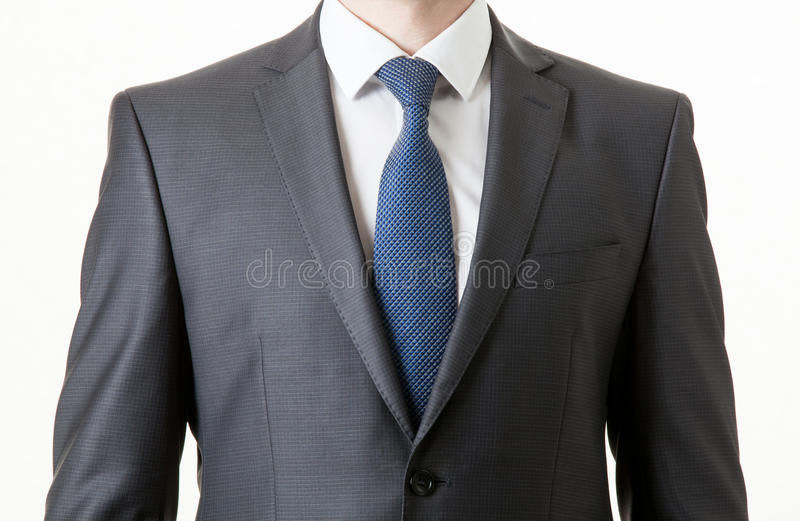 Unrecognizable businessman in a classical suit. White background stock photos