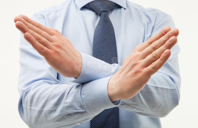 Unrecognizable businessman demonstrating a gesture of a rejecti. On, white background stock photography