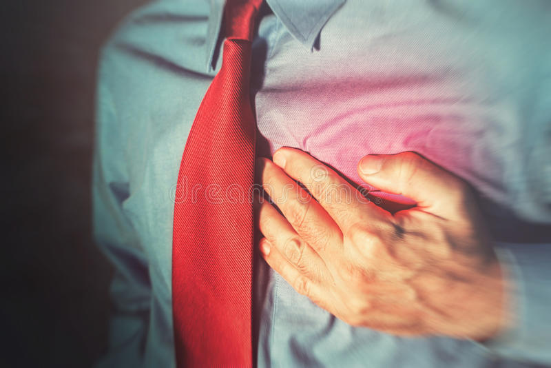Unrecognizable businessman having chest pain and heart attack royalty free stock image