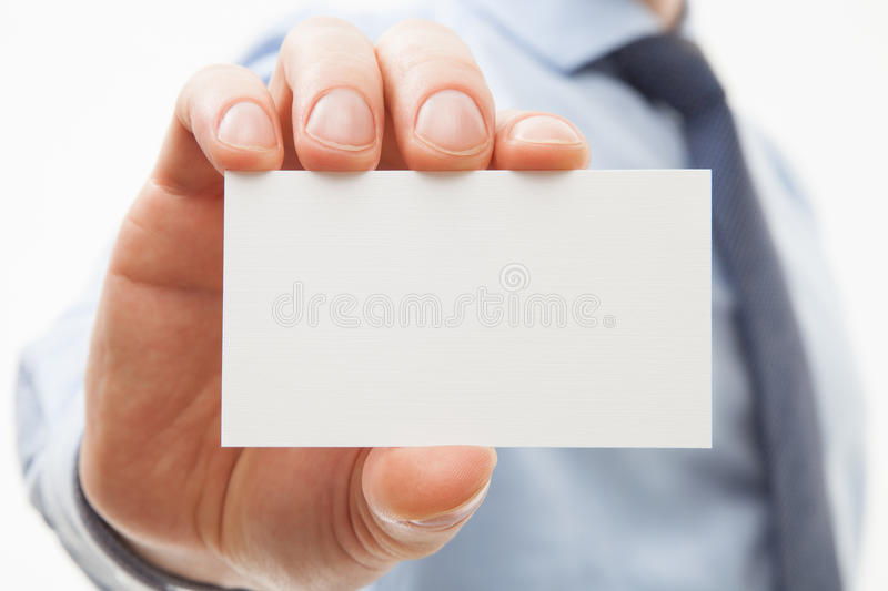 Unrecognizable businessman showing business card. Closeup shot royalty free stock photos