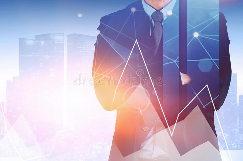 Crossed arms businessman in city, graph stock images