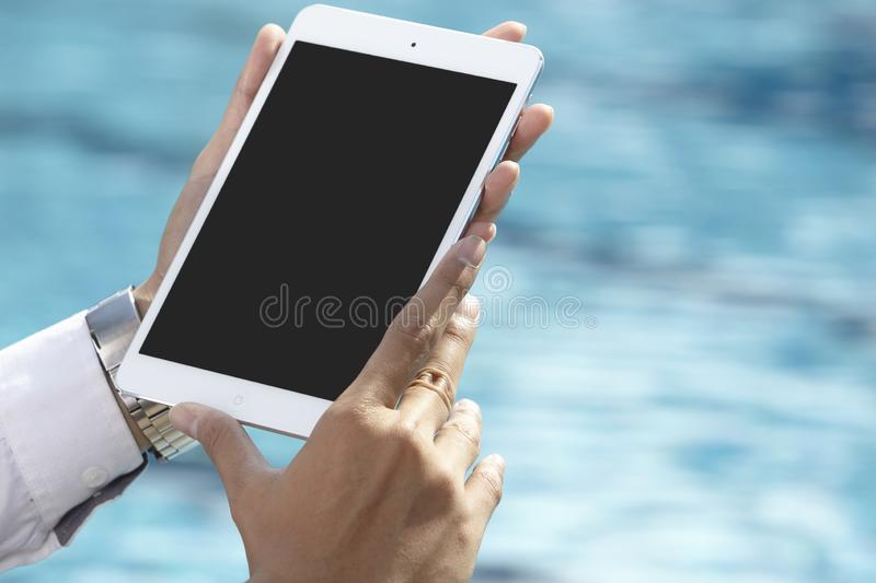 Unrecognizable businessman using phone. On pool side stock photos