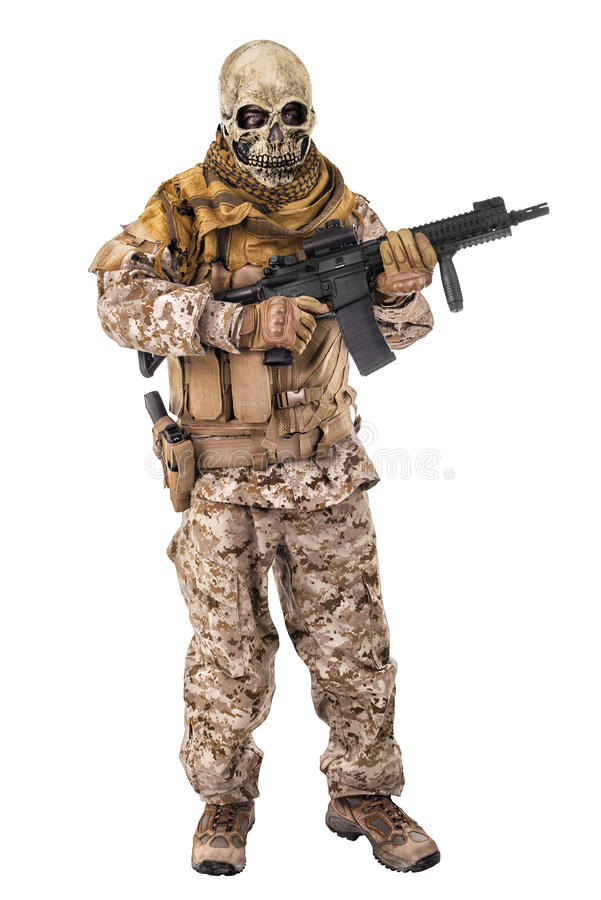 Unrecognizable criminal holding a rifle. royalty free stock photography