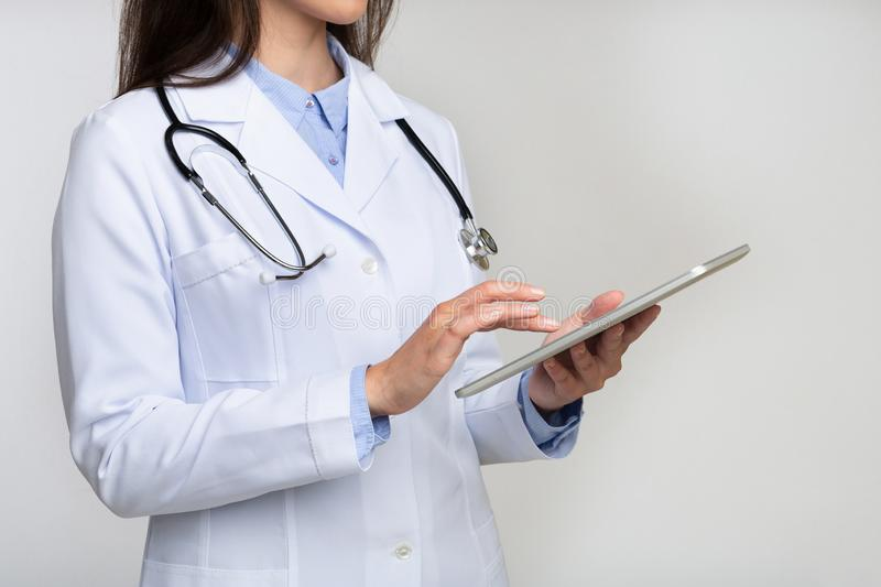 Unrecognizable Doctor Using Digital Tablet On White royalty free stock photos