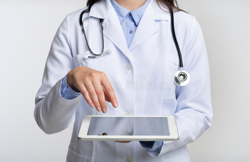 Unrecognizable Doctor Using Tablet Computer, White Background, Cropped stock images