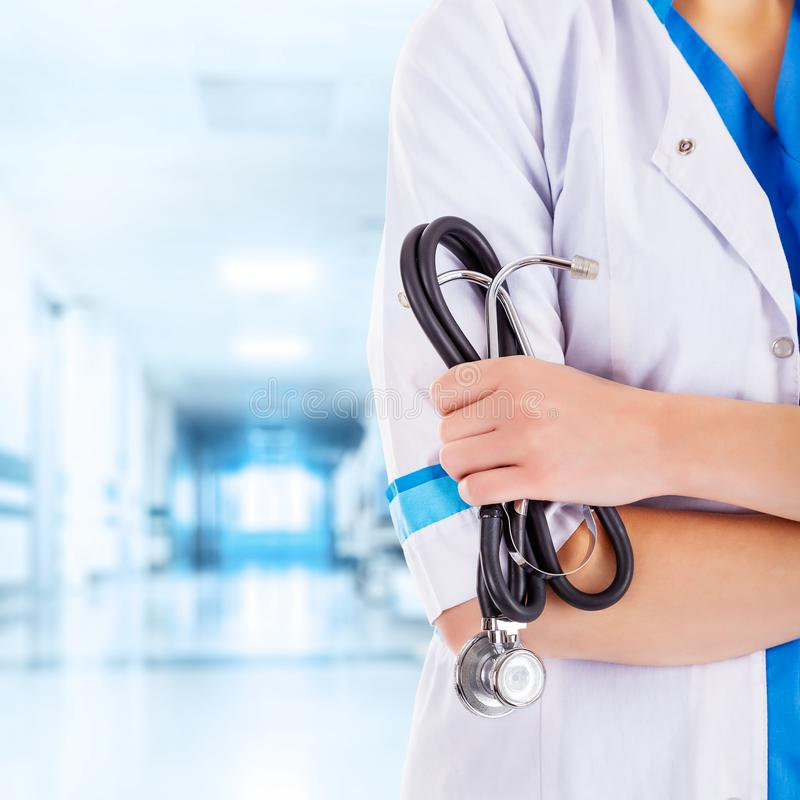 Unrecognizable Female Doctor with Stethoscope in Hand in the Hallway stock photos