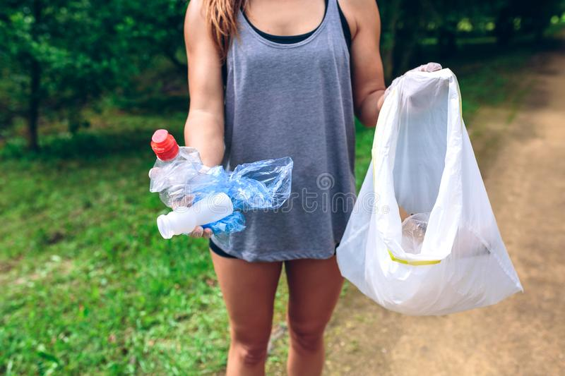 Unrecognizable girl showing garbage royalty free stock photography