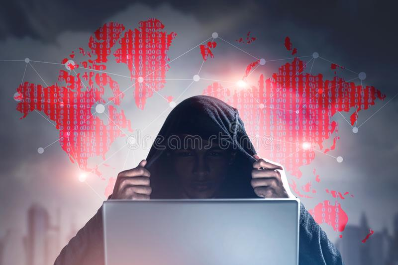 Hacker In A Black Hoodie, Binary Code Stock Photo - Image of