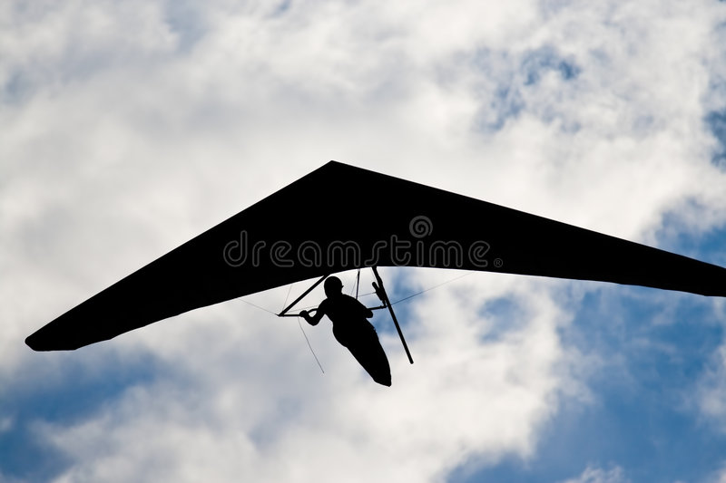 Unrecognizable hangglider pilot in the blue cky royalty free stock photography