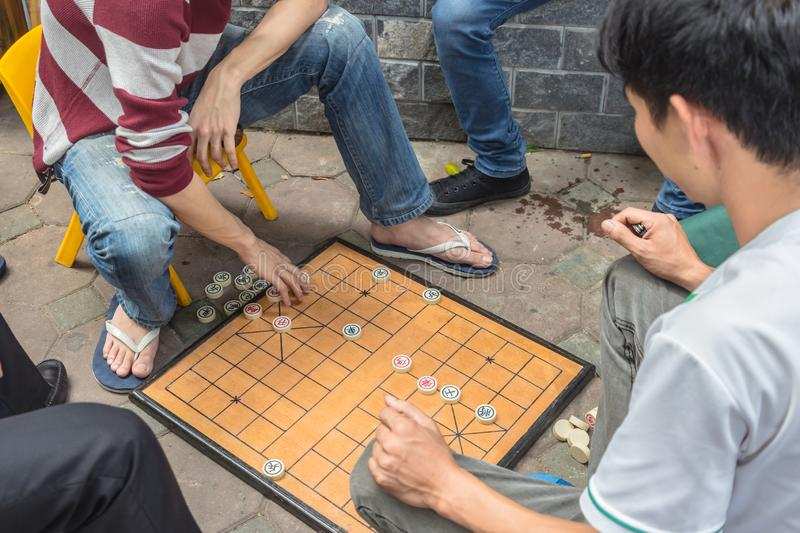 Unrecognizable man plays traditional board game known as chinese chess stock images