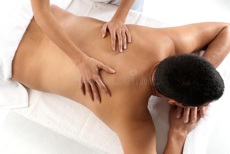 Unrecognizable man receiving massage relax. Treatment close-up from female hands stock photo