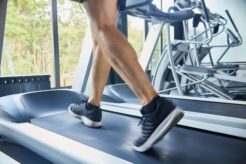 Unrecognizable Man Running on Treadmill stock images