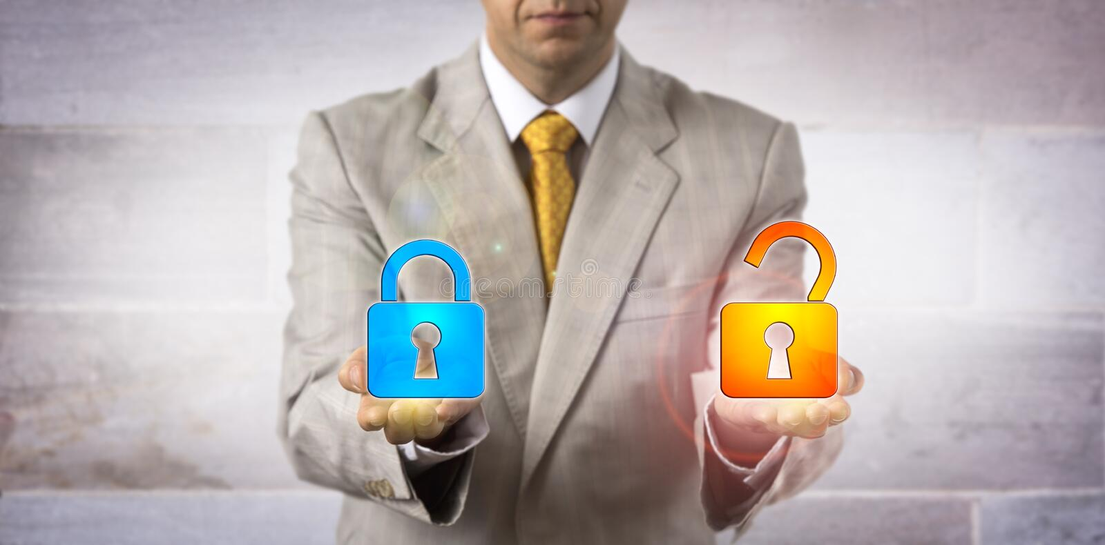 IT Manager Showing A Locked And An Open Padlock. Unrecognizable IT manager presenting one locked and one open virtual padlock in his hands. Concept for access stock photography