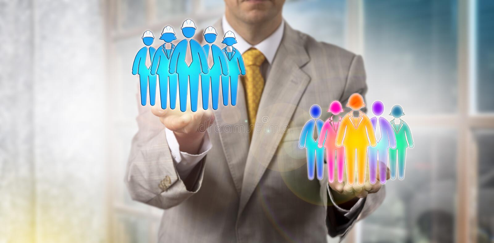 Man Lifting Blue Collars Over Multicultural Team royalty free stock images