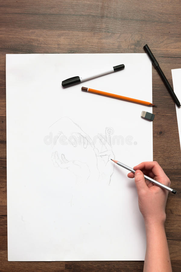 Unrecognizable painter draws hands flat lay stock image