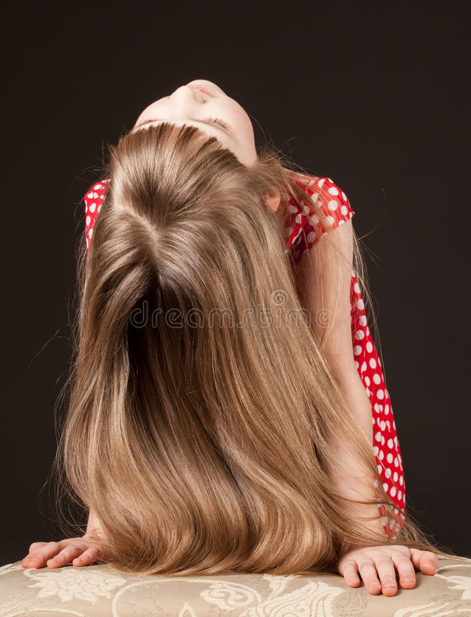 Unrecognizable portrait of a little girl with beautiful long hair royalty free stock photo