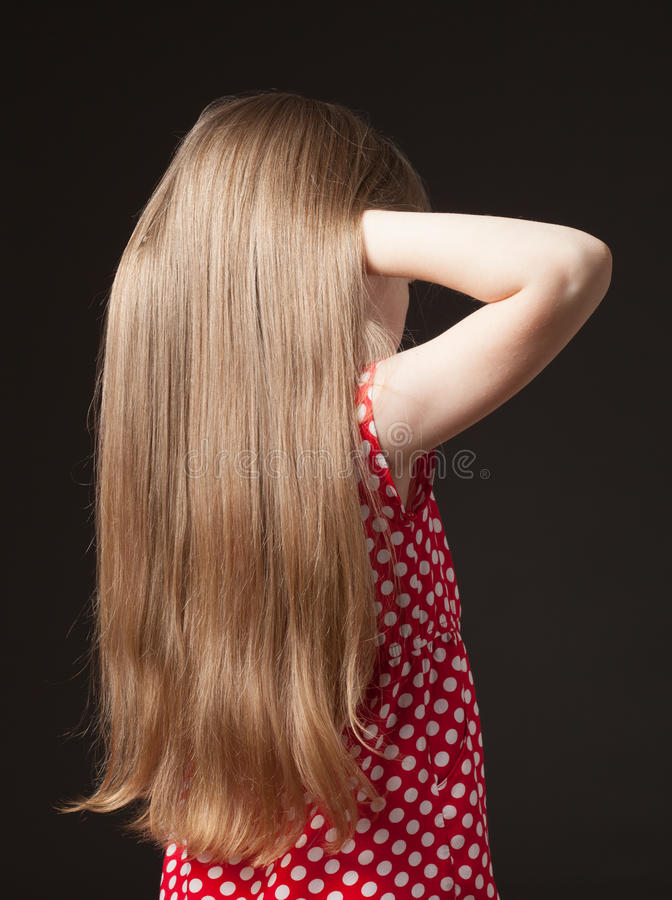 Unrecognizable portrait of a little girl with beautiful long hair stock photos