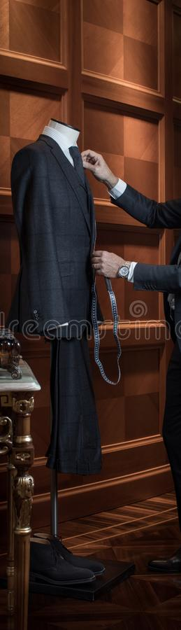 Tailor measuring suit on dummy royalty free stock images