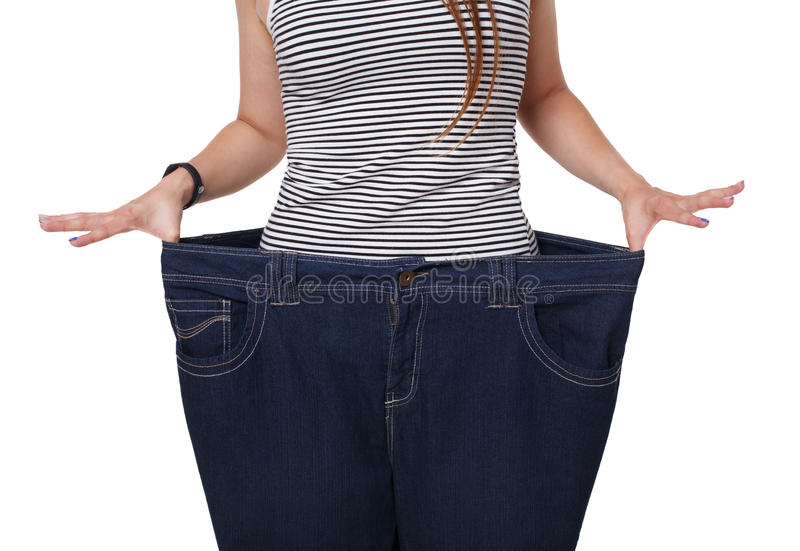 Unrecognizable woman torso, showing diet results isolated on white stock image