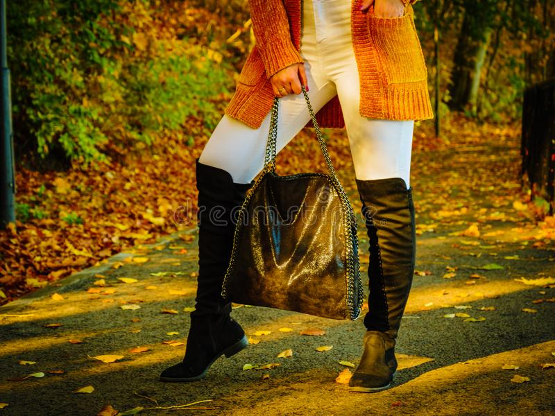 Woman wearing orange autumn cardigan outdoor royalty free stock images