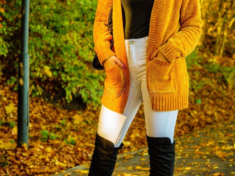 Woman wearing orange autumn cardigan outdoor stock photo