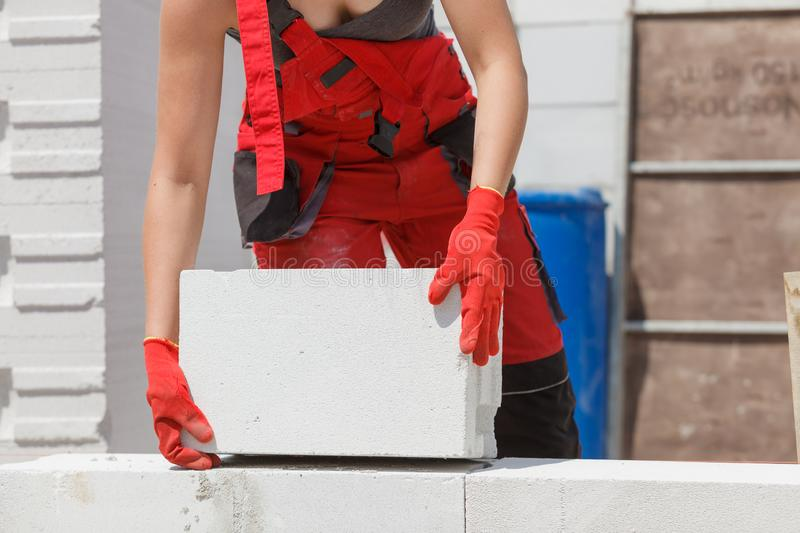 Woman working with airbricks royalty free stock photography