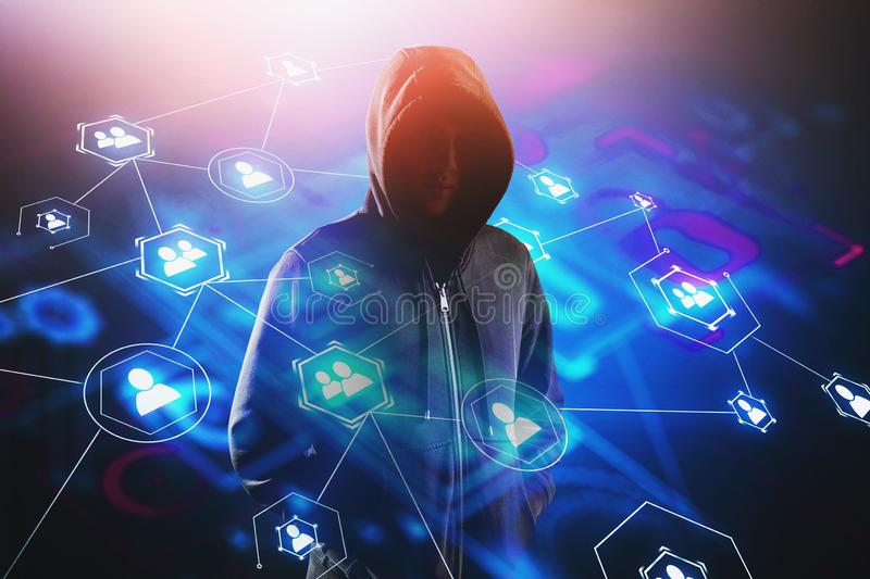 Hacker and social media interface. Unrecognizable young hacker standing over blurry background with double exposure of social media interface. Concept of cyber royalty free stock image